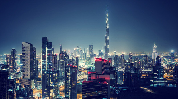 View of Burj Khalifa and Dubai skyline at night